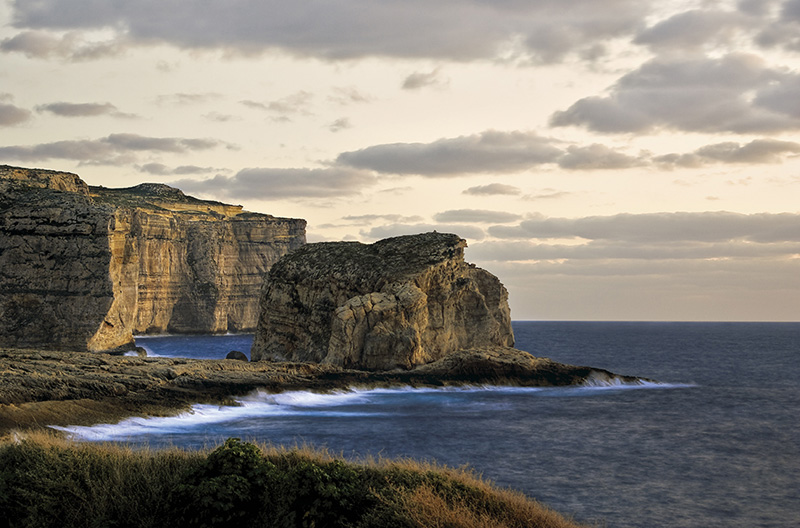 The Fungus Rock located in the North of Gozo gets its name from the important medicinal fungus which was found growing on it, way back in time, when the Knights of St. John ruled the islands. © Clive Vella